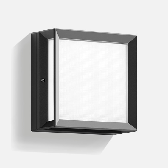 Impact-resistant ceiling and wall luminaire